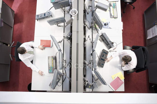 Top view of security officers at workplaces in open-space office — Stock Photo
