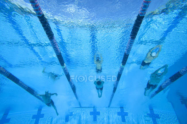 Underwater view of male sportsmen in swimming pool — Stock Photo