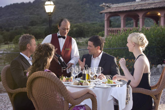 Waiter presenting wine bottle — Stock Photo