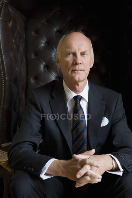 Front view of senior businessman in armchair — Stock Photo