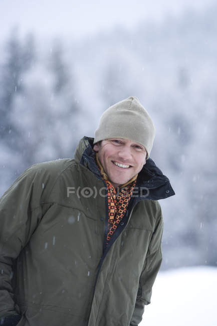 Portrait of mid adult man standing in snow — Stock Photo