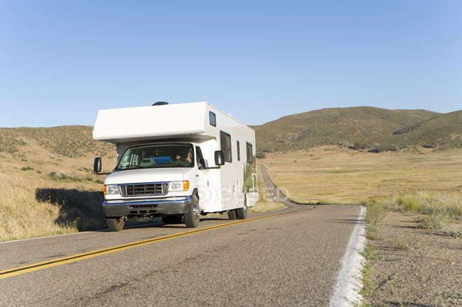 Low angle view of white motor home on road — Stock Photo