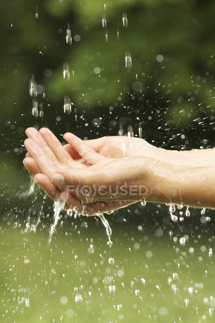 Female hands washing in shower — Stock Photo