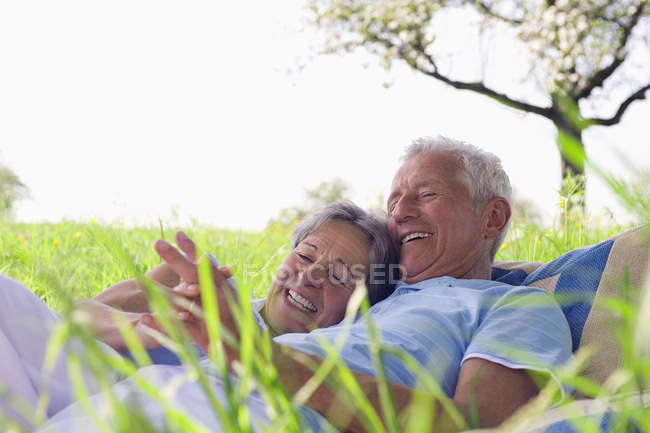 Senior couple hugging and holding hands — Stock Photo