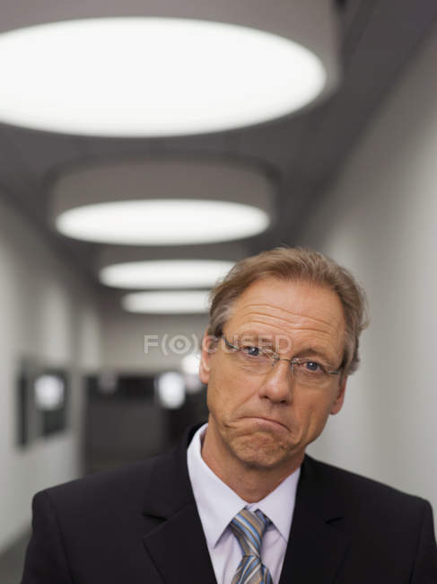 Businessman with sad face looking at camera — Stock Photo