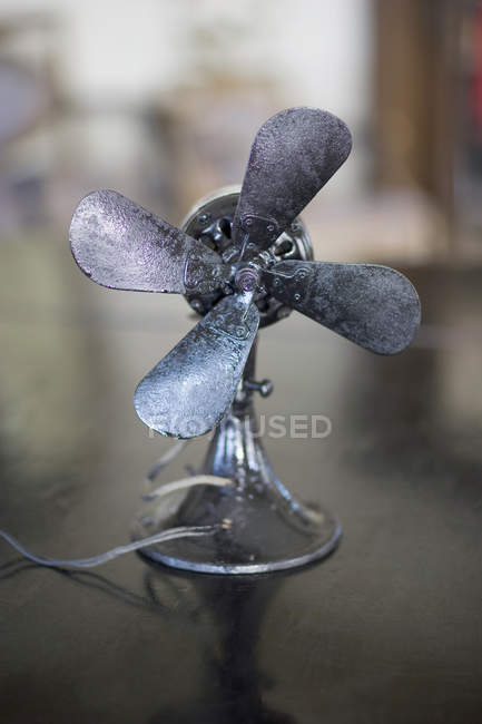 Vintage fan on table — Stock Photo