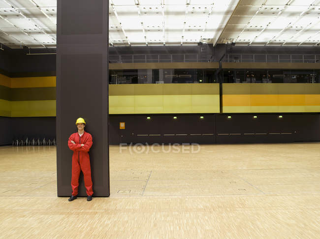 Worker posing by metal dividing wall in conference center — Stock Photo