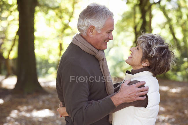 Smiling senior couple looking at each other — Stock Photo