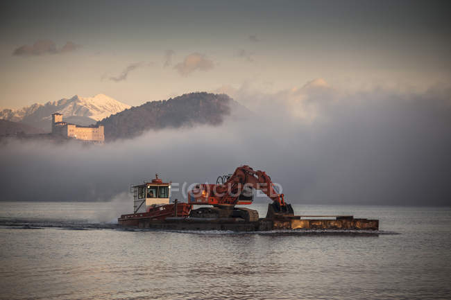Digger on boat, Lake Maggiore, Piedmont, Lombardy, Italy — Stock Photo
