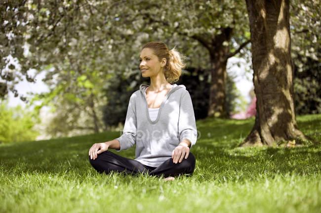 Woman performing yoga asana — Stock Photo