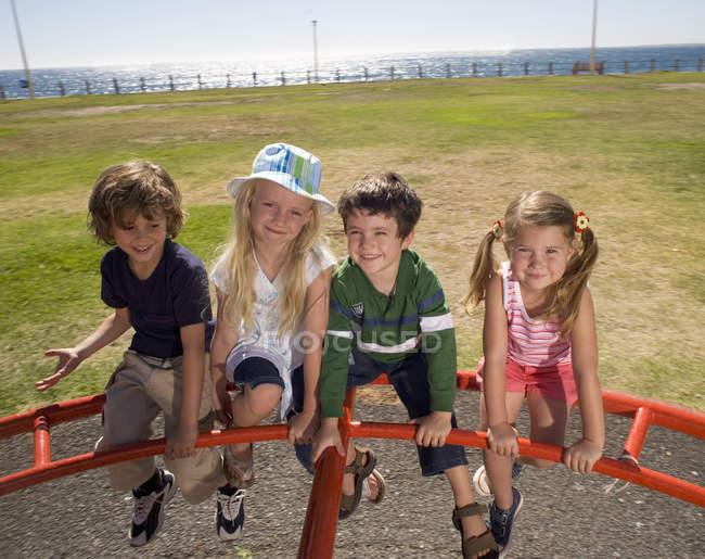 Four children on a playground — Stock Photo