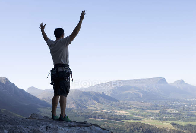 A climber celebrating reaching the top — Stock Photo