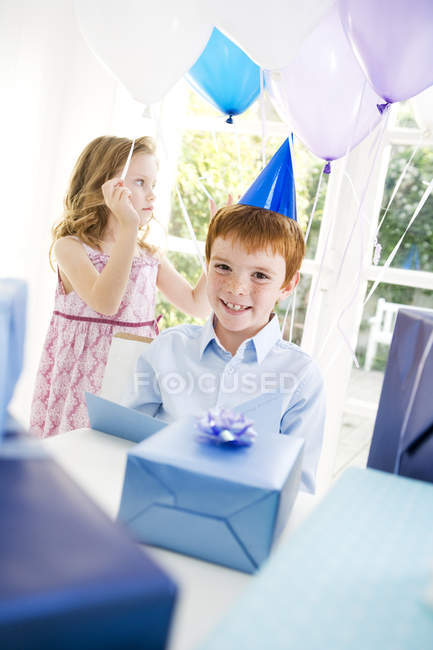 Boy and girl at birthday party — Stock Photo
