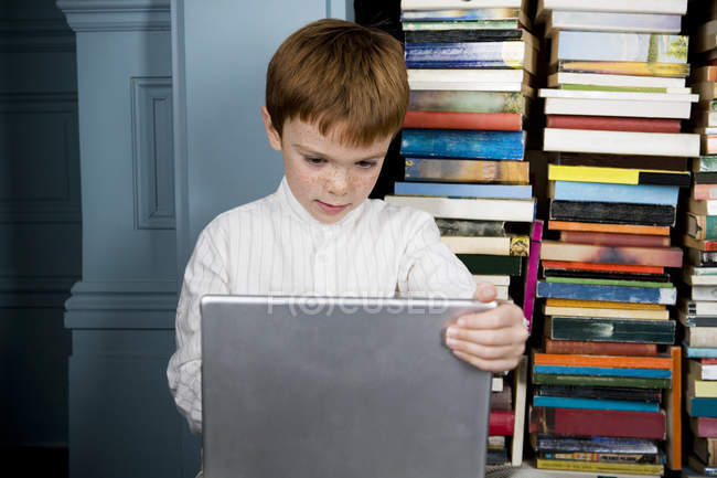 Boy with laptop computer — Stock Photo