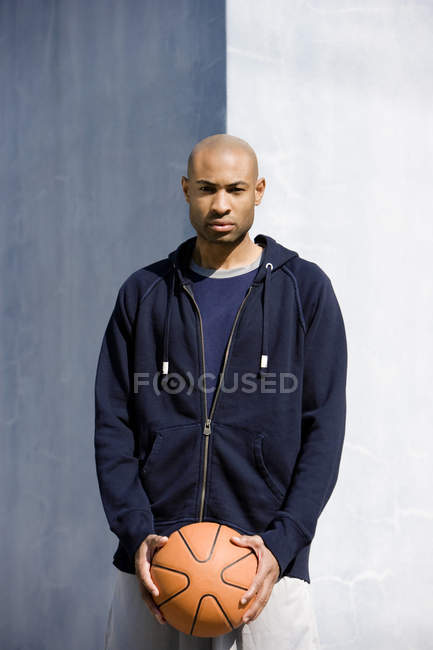 Portrait of young African American man holding a basketball — Stock Photo