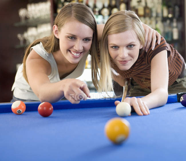 Two teenage girls playing billiards — Stock Photo