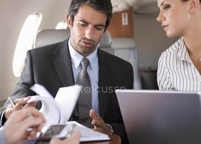 Three business colleagues working on a flight — Stock Photo