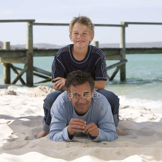 A father and son on a beach — Stock Photo