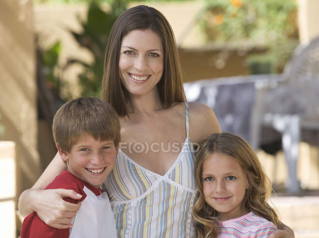 Portrait of a mother with her young son and daughter — Stock Photo
