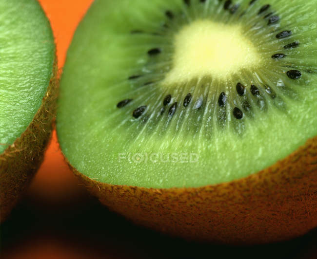 Closeup halved kiwi at table — Stock Photo