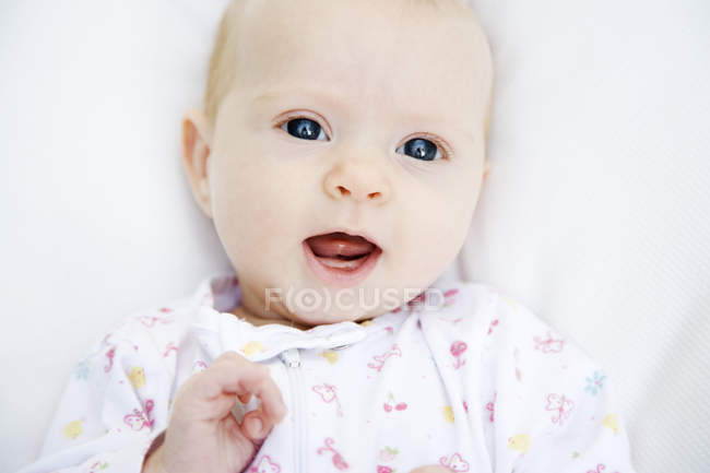Portrait of little baby in white clothes — Stock Photo