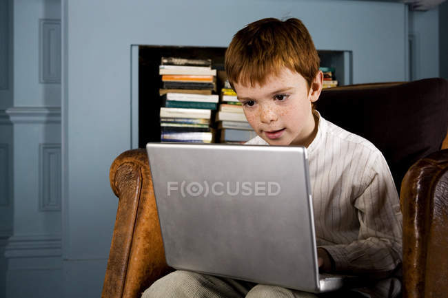 Boy looking at laptop computer — Stock Photo