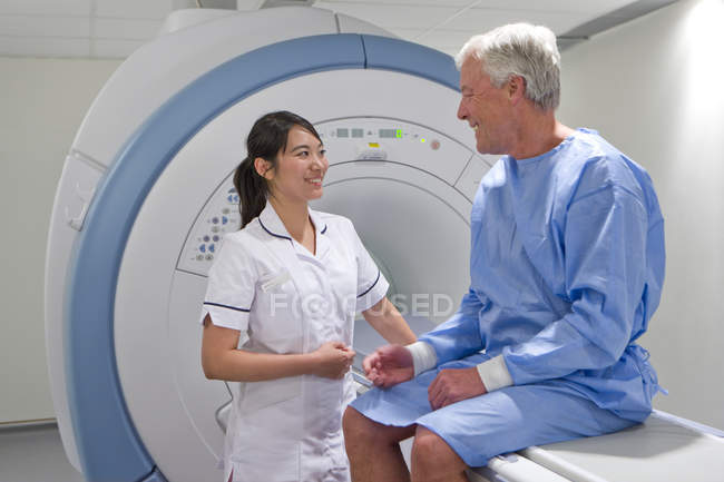 Radiologist looking at patient — Stock Photo