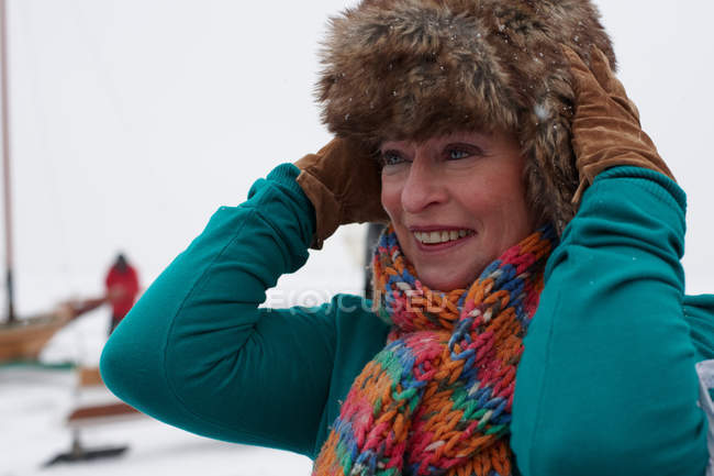 Senior woman wearing fur hat in winter day — Stock Photo
