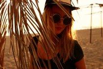 Woman in soft sun light on beach — Stock Photo