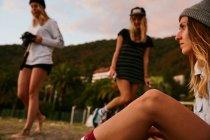 Women having fun together on windy beach — Stock Photo