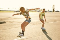 Women riding on skateboards — Stock Photo