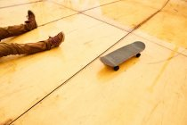 Skater sitting with board on ramp — Stock Photo