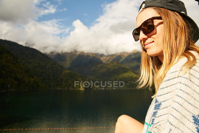 Woman posing on landscape with lake — Stock Photo