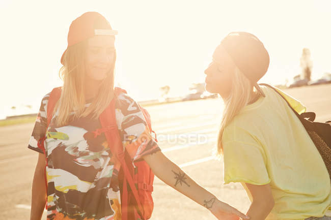 Women in soft light in caps backwards — Stock Photo