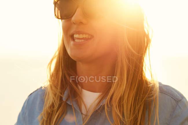 Woman enjoying soft sun light — Stock Photo