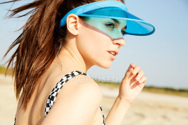 Woman in blue visor — Stock Photo