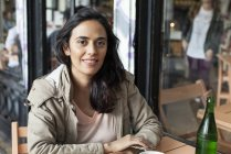 Portrait of smiling Woman sitting  at cafe — Stock Photo