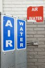 Close up of Signs advertising air and water pumps — Stock Photo