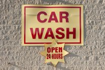 Close up of Car wash sign hanging on the wall — Stock Photo