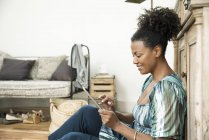 Woman using digital tablet at home — Stock Photo