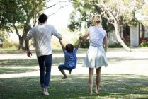 Family with one child relaxing together outdoors picnic — Stock Photo