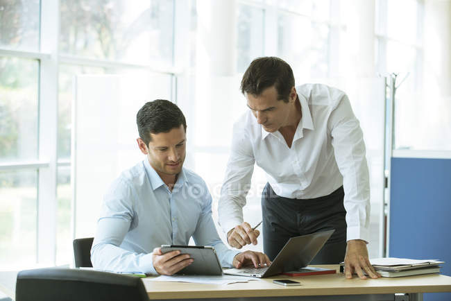 Businessmen working together in the office — Stock Photo