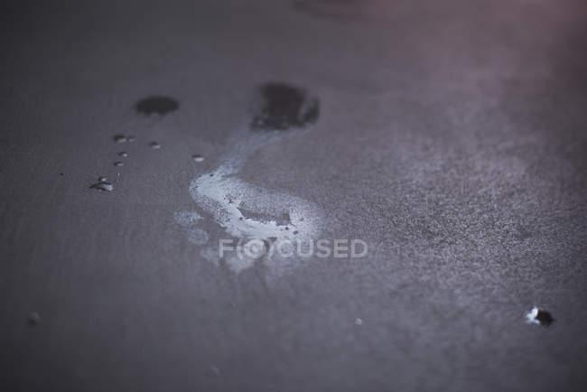 Wet footprint on floor — Stock Photo