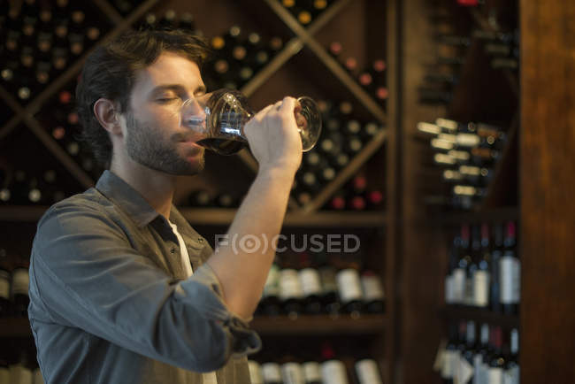 Sommelier tasting glass of wine — Stock Photo