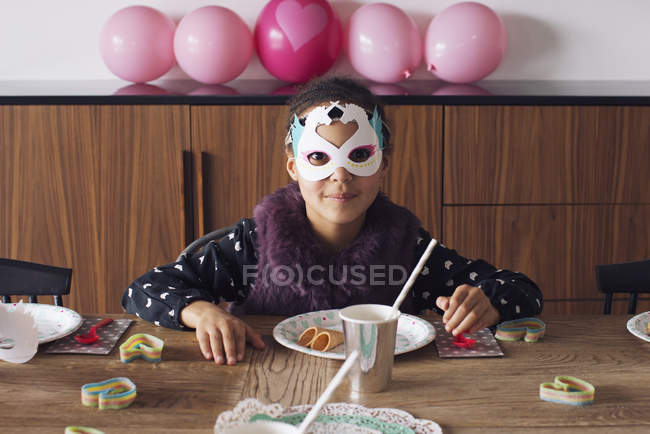 Girl wearing festive mask at birthday party — Stock Photo