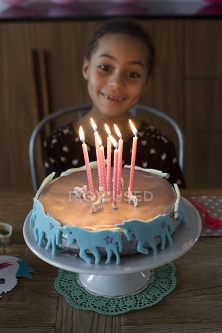 Girl preparing to blow out candles on birthday cake — Stock Photo