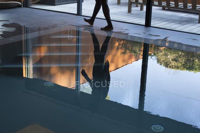 Man walking beside pool — Stock Photo