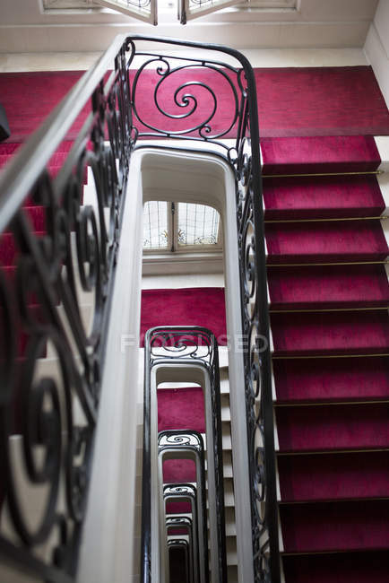 Staircase with red carpet — Stock Photo