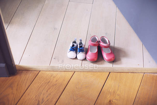 Children's shoes side by side — Stock Photo