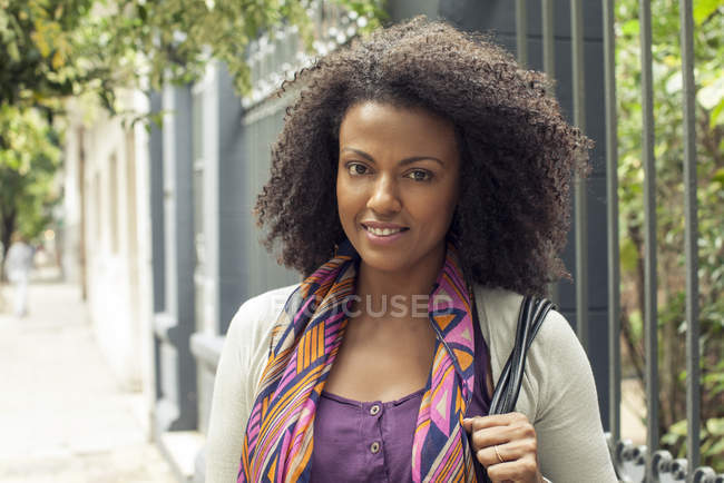Portrait of Woman with curly hair outdoors — Stock Photo